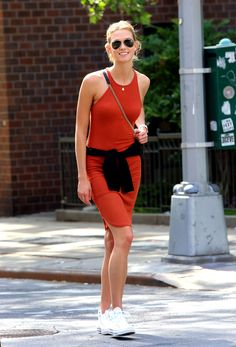 Karlie Kloss makes her bodycon knit dress more casj with her Converse <3