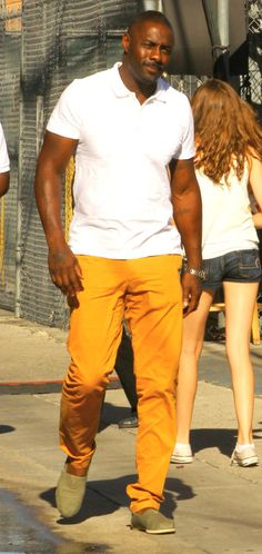 Only this man can pull off wearing tangerine pants