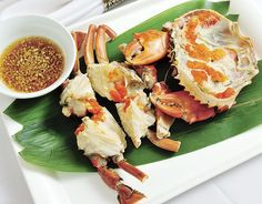 Pinoys have developed a selective memory whenever they're served freshly cooked crab on banana leaves, with rice and a vinegar dip. #crab #food #Philippines
