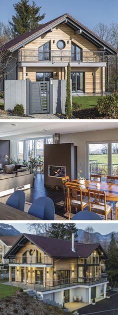 Einfamilienhaus in Hanglage mit Satteldach Architektur im modernen Landhausstil - Fertighaus aus Holz bauen Haus am Genfer See von WeberHaus - HausbauDirekt.de