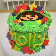 Dora - Dora cake in buttercream with FBCT on top.  Fondant stars and letters.
