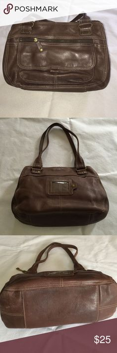 """Brown Leather Fossil Purse Gently used (some wear on bottom shown in photo), this vintage Fossil bag has many pockets on the exterior and in the interior. Magnetized enclosure and brass grommet details. Interior is in excellent condition. 14"""" wide x 8 1/2"""" tall x 5 1/2"""" deep on the bottom. Shoulder drop for straps is 10"""" Fossil Bags Shoulder Bags"""