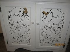 Great Grandma's old china cabinet with vinyl birdie doors