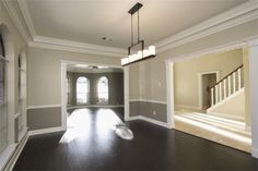 Two tone wall with chair rail and dark hardwood - dining room