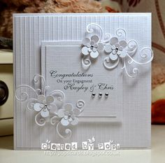 """CAS, with that lovely white on white look, which is perfect for a wedding (or christening/baptism card). I can see this with a little pop of either gold or silver in the flower centres & as a small (1/8"""" or 1/16"""") borders on all the squares. It would just step it up that little bit more."""