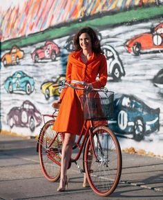 Featured in the NY TImes Style Section, our classic RIDING COAT DRESS in Cinnabar Flash is made from a light-weight poly that has 3M Scotchlite™ Reflective thread woven into a discreet window pane pattern. The fabric also has a water-resistant and breathable wicking finish. 3M Scotchlite reflective buttons adorn the co