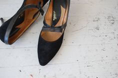 Vintage 1960s black mary jane style heels with big center bow and skinny heel. --- M E A S U R E M E N T S ---  fits like: us 6.5 | euro 37 | uk 4 insole: 9.5 ball: 3 heel: 3 brand/maker: condition: excellent  ➸ more vintage footwear http://www.etsy.com/shop/DearGolden?section_id=5800174  ➸ visit the shop http://www.DearGolden.etsy.com _____________________  ➸ blog | www.deargolden.com ➸ twitter | deargolden ➸ facebook.com | deargolden