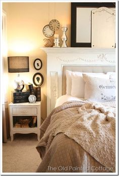 Use a mantle with a padded insert as a headboard. Love that you can put candles on the mantle - so romantic!