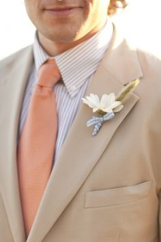 Want something lighter? Pastel shades are perfect for summer wedding. This light brown suit and peach tie are great match.