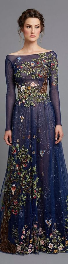 .Detailed woodland embroidery on a fairy tale gown the shades of night