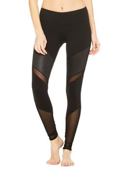 For those who put their mat in the front of the room, the contemporary Sheila Legging demands attention with glossy moto-inspired V stripes and shiny power mesh panels. Check your chair pose in these. Hidden key/card pocket in waistband.