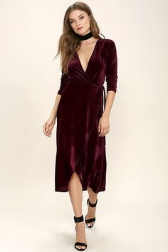 The Enchant Me Burgundy Velvet Midi Wrap Dress is bewitchingly beautiful! Velvet is soft and stretchy across long sleeves and a wrapping surplice bodice, with a tying waist. Wrapped detail carries into a front slit midi skirt.