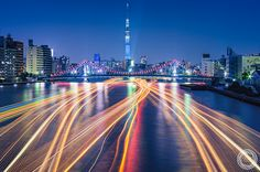 https://flic.kr/p/zZ289F | River of Lights, Tokyo Sumidagawa | Light trails of house boats on Sumida river with Tokyo Sky Tree in blue lit, Kiyosu-Bashi Bridge in a twilight time. Taken from Sumidagawa-Ohashi Bridge, Chuo Ward / Koto Ward, Tokyo.  Pentax K-3, smc PENTAX-DA 18-55mm F3.5-5.6 AL WR with C-PL filter. On October 24, 2015, 17:31. Focal 38mm / Aperture f11 / Exposure 133s and and other 3 images exposed over 120 seconds. RAW development (16bit TIFF) in Adobe Photoshop Lightroom CC…