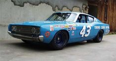 Richard Petty  When Petty was at war with mopar driving a Ford.
