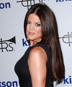 dark hair | Khloe Kardashian dark hair orange earrings photo | Posh24.com