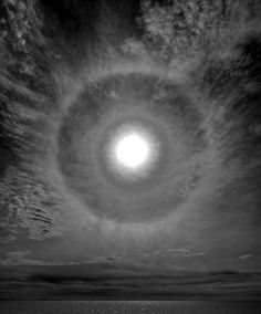 "A moondog or paraselene (plural paraselenae, i.e. ""beside the moon"") is a relatively rare bright circular spot on a lunar halo caused by the refraction of moonlight by hexagonal-plate-shaped ice crystals in cirrus or cirrostratus noctilucent clouds."