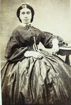 Looks to be a Married lady with separate bodice and skirt combination.