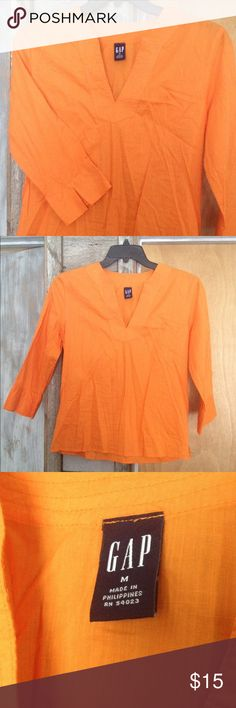 GAP V Neck Lightweight Summer Top Orange M This GAP top reminds me of a dreamsicle!  Perfect summer top for over your favorite bathing suit or over a cute tank. Light, comfortable, bright and beautiful for summer! Orange v neck, 3/4 length sleeves, women's size M. GAP Tops