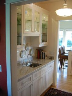 Off white cabinets with contrasting island and a simple raised panel door