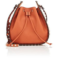 Valentino Women's Rockstud Bucket Bag ($1,295) ❤ liked on Polyvore featuring bags, handbags, shoulder bags, orange, orange purse, shoulder strap handbags, drawstring handbags, red purse and valentino handbags