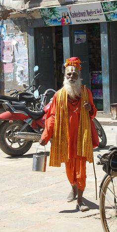 A holy man (Sadhu) on the streets of Kathmandu, Nepal. The sadhu way of life can take a variety of forms. Sadhus may live together in monasteries (mathas) belonging to a particular order or isolate themselves in small huts or caves, but many wander throughout the country alone or in small groups.