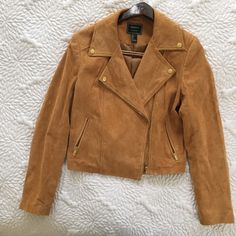 Cognac real suede moto jacket with gold hardware Like new, without tags! Gorgeous cognac suede moto style jacket with gold hardware. Size L, fits like a M. Cropped back with quilted detail. Long sleeves. Lined. Super comfortable and looks great with almost every color. (I'm a non-smoker with no pets) :) Forever 21 Jackets & Coats