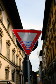 Modified traffic signs by street artist Clet Abraham are everywhere in Florence, Italy.