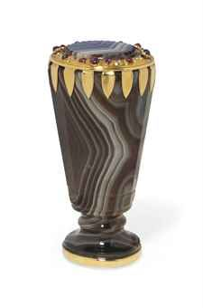 """CONTINENTAL GOLD-MOUNTED AGATE DESK SEAL  STAMPED """"750"""", PROBABLY EARLY 20TH CENTURY  The tapering faceted handle with a plain lower mount, the upper mount set with a band of diamonds and cabochon rubies, the seal base uncut"""