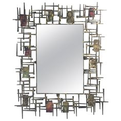 Brutalist Nail and Metal Mirror in the Manner of Silas Seandel | From a unique collection of antique and modern wall mirrors at https://www.1stdibs.com/furniture/mirrors/wall-mirrors/