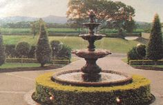 I love circular driveways, water fountains, hedges and - isn't that view spectacular?!