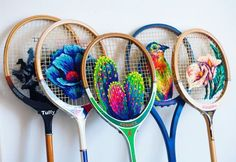 Wow! What a creative use for vintage tennis rackets. ||| Danielle Clough goes beyond the embroidery hoop to create colorful stitches in unusual places. Using vintage rackets as her frame, she fills their plastic grids with flowers and succulents. They seemingly float on top of it, but are secured by a combination of stitches, knots, and needles.