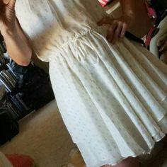 BEBE dress sz M  halter type cream color nwot BEBE beautiful dress. Cream color w/ gold flakes. Flow skirt.lined. BEBE  Dresses Backless