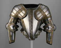 Jacob Halder  English, Greenwich, active c. 1590    Portions of an Armor for Field and Tilt, c. 1580/90    Steel with gilding, iron, brass, leather  H. (mounted with arm defences) 61 cm (30 in.)  Wt. 39 lb. 10 oz. - Art Institute of Chicago