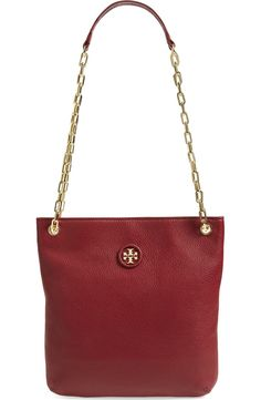 Obsessing over this rich leather crossbody bag in red by Tory Burch. A…