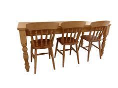 A beautiful solid pine table with thick tuned legs that comfortably seats 8.