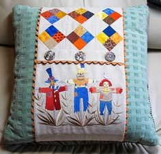 9-28-14 Autumn Pillow Wrap   Pieced 4-patch blocks set on-point and machine embroidered scarecrows, my design.