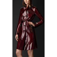 Beyonce Wears Burberry Vinyl Oxblood Trench Coat ❤ liked on Polyvore featuring outerwear, coats, oxblood coat, red trenchcoat, burberry coat, trench coat and burberry trenchcoat