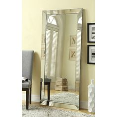 Features: -Finish: Silver. -Will easily be mounted to wall by use of included wall anchors. . Shape: -Rectangle. Style: -Contemporary. Beveled Glass: -Yes. Mirror Type: -Full Length. Orientatio