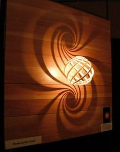 Loxodrome Sconce Printing Wonders printed Loxodrome Lamp, which illuminates a double spiral of light onto the wall using stereographic projection.