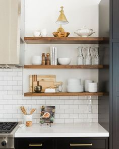 Boston Single Arm Library Light placed over open kitchen shelves. Love the styling on these shelves! Kitchen Design Open, Open Shelf Kitchen, Kitchen Shelf Decor, Open Shelving In Kitchen, Kitchen Designs, Floating Shelves In Kitchen, Basic Kitchen, Ikea Kitchen Drawer Organization, Open Cabinets In Kitchen