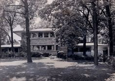 """July 5, 1955 photo - Raymond W. Evans House, / 9914 South Longwood Drive, Chicago IL / 1908 / Prairie / Frank Lloyd Wright -- Though the Raymond Evans House was originally faced in stucco, not concrete, the design is identical in appearance to that of """"A Fireproof House for $5,000"""", but with two wings flanking the central massing of the house instead of a single wing in the article's sketches. The synthetic stones that now cover the house were not of Wright's doing."""
