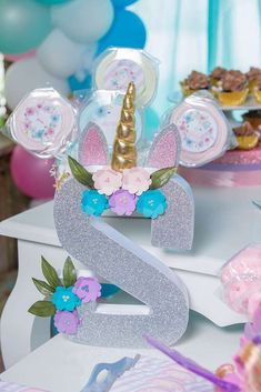 The unicorn decorated monogram letter at Unicorn Birthday Party is so pretty!! See more party ideas and share yours at CatchMyParty.com #catchmyparty #unicornbirthdayparty #partydecorations
