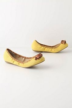 I love the moccasin take on the classic yellow flat. Add some fringe and everything is more fun.