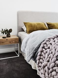 Cosy bedroom with our super cosy wool chunky knit throw blanket www.closelyknit.com.au