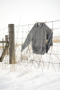 sweater on a fence, winter