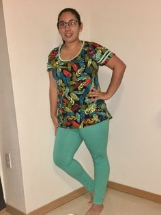 LulaRoe Feather classic tee, with solid mint leggings.   Follow me for the newest LulaRoe products and prints.  https://m.facebook.com/Lularoe-Elizabeth-Burk-594634584074087/