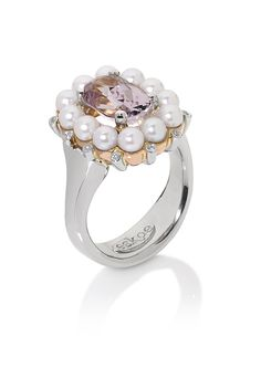 www.eskaejeweller.com.au  This is a dress ring I did for some friends of mine. The centre stone is a pink Kunzite which I surrounded with small pearls of a pinkish hue, and some little diamonds in between for some added sparkle. This was made in 18ct rose and white gold. P.O.A