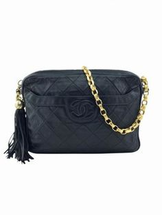 Chanel Quilted Lambskin Leather Tassel Camera Case Shoulder Bag. Get one of the hottest styles of the season! The Chanel Quilted Lambskin Leather Tassel Camera Case Shoulder Bag is a top 10 member favorite on Tradesy. Save on yours before they're sold out!