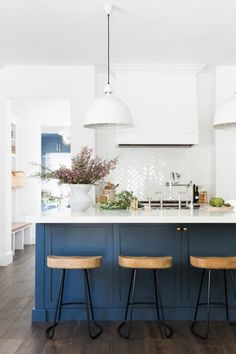 Beautiful white and blue kitchen with gold accents #bluekitchens #bluedecor #kitchendesign #kitchendecor #kitchenremodel #blueandwhitekitchen