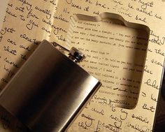 Secret Safe Books: hides a flask in a hollowed-out book - great gift for a groomsmen. Image via Etsy.